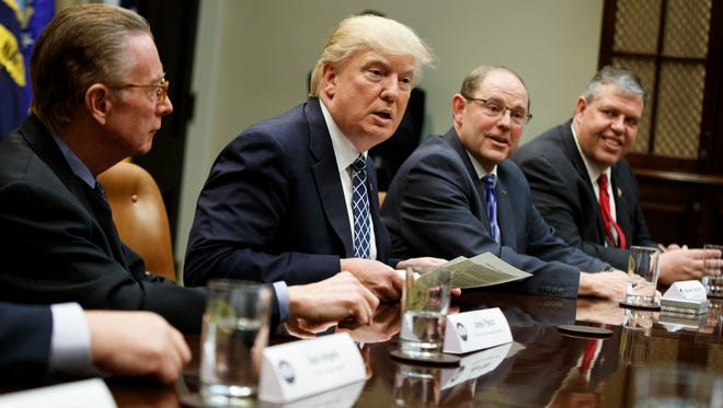 President Donald Trump speaks during a meeting with the Fraternal Order of Police, Tuesday, March 28, 2017, in the Roosevelt Room of the White House, Tuesday in Washington. From left are, Jim Pasco, Senior Adviser to the National FOP President, Trump, National Fraternal Order of Police President Chuck Canterbury, and Jason McDonald, National Vice President FOP. (AP Photo/Evan Vucci)
