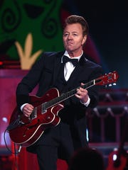 Brian Setzer performs during CMA's Country Christmas special taping at the Grand Ole Opry on Nov. 7, 2015.