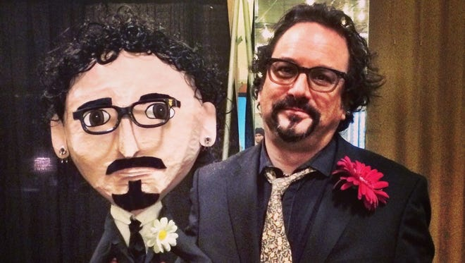 """Ashwaubenon native Jim Runge, tour manager for The Black Keys and Empire of the Sun, is up for Road Warrior of the Year at Friday's Pollstar Awards. He won the honor in 2014. The pinata likeness he's holding was a gift from a promoter in Vancouver, British Columbia, for the band to hit after the show. """"But they were afraid ... so it still lives,"""" Runge says."""