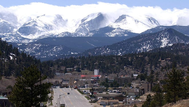 --04-20-2003, E1ESTES PRIMED FOR SUMMER VISITORS: Snow covers the mountains of Rocky Mountain National Park as Estes Park enjoys a sunny day last week. Below, diners eat at Poppy's Pizza and Grill in downtown Estes Park. Town officials and business owners are optimistic that the summer tourism revenues will be better this year after a down year in 2002.Photos by V. Richard Haro/The Coloradoan--Snow covers the mountain of Rocky Mountain National Park as Estes Park enjoys a sunny day Wednesday Apil 16, 2003.