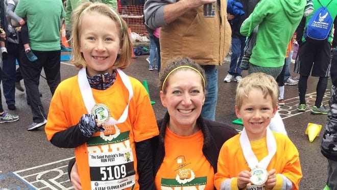 Chambersburg's Erin Metcalfe and her children, 7-year-old Adelyn and 4-year-old Christian, took part in the Saint Patrick's Day Running Festival in Hagerstown. Erin ran the 8K race while her kids ran the Kids Clover race.