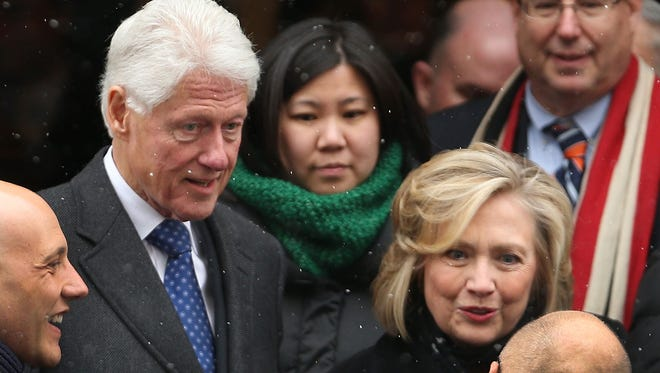"Former President Bill Clinton and his wife, former Secretary of State Hillary Clinton, leave St. Ignatius Loyola Church after the funeral of former three-term governor Mario Cuomo on Jan. 6, 2015. The Clintons' White House years are the focus of the satirical musical ""Clinton the Musical,"" coming to Off-Broadway's New World Stages in March."