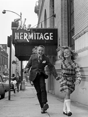 Darr, left, and Drusie Hall play June 15, 1965 in front of their home, The Hermitage Hotel, were their father, Dick Hall, is the manager. The hotel is the only home the two have ever known.