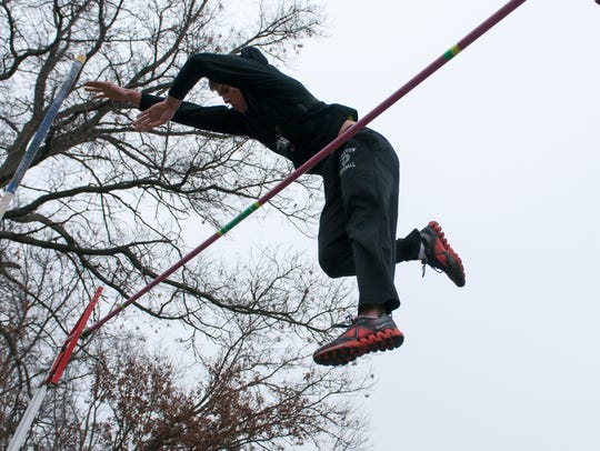 Lakeview senior Michael Martin clears the bar at a