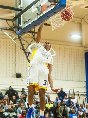 DUNK OF THE WEEK: Wicomico's Lionel Batson lays down a one-handed slam against Washington on Tuesday.