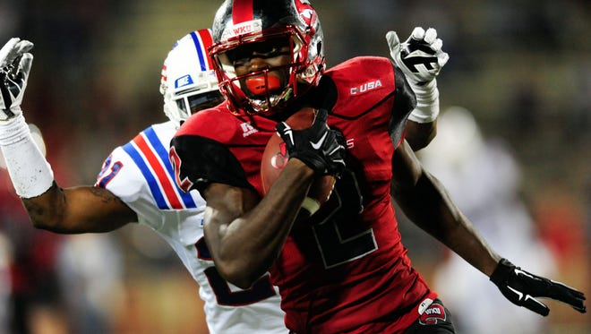 Sep 10, 2015; Bowling Green, KY, USA; Western Kentucky Hilltoppers wide receiver Taywan Taylor (2) runs the ball against Louisiana Tech Bulldogs cornerback Adairius Barnes (21) during the second half at Houchens Industries-L.T. Smith Stadium. Western Kentucky Hilltoppers won 41-38. Mandatory Credit: Joshua Lindsey-USA TODAY Sports