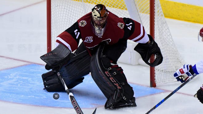 Arizona Coyotes goalie Mike Smith (41) pokes the puck during the second period against the New York Rangers at Gila River Arena earlier this season.