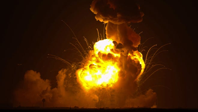 In a series of photos made available by photographer Rob Graff, an unmanned Orbital Sciences Corp.'s Antares rocket headed for the International Space Station lifts off from the Wallops Flight Facility on Wallops Island, Va. on Tuesday, Oct. 28, 2014 shortly before exploding. No injuries were reported following the first catastrophic launch in NASA's commercial spaceflight effort.