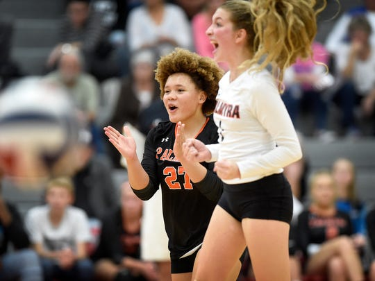 Palmyra's Kirsten West and Jacklyn Baker cheer as they watch a Garden Spot ball fly out of bounds during the 3A district girls volleyball semifinal at Hempfield High School Thursday night, Nov. 2.