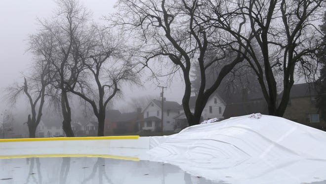 Mansfield City Parks employees were making repairs to the liner of an ice rink in Prospect Park on Tuesday. Over the past weekend vandals punctured holes that damaged the liner.