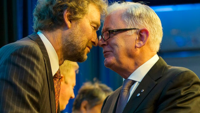 Daid Walker, left, New Zealand's lead negotiator performs hongi (traditional Maori touching of noses welcome) with Australia's Andrew Robb, Minister for Trade and Investment at the signing of the Trans Pacific Partnership Agreement signing, SkyCity Conference Centre,  New Zealand, on Thursday.