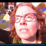 """A video still of communications professor Melissa Click calling for """"muscle"""" to evict journalists from private property."""