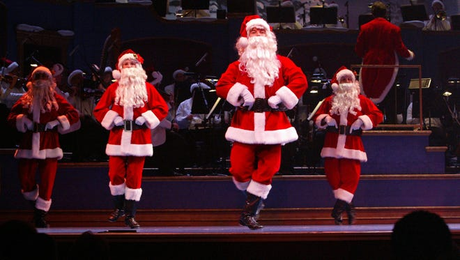 A troop of dancing Santas took to the stage during the IPL Yuletide Celebration in 2011. This year's program run Dec. 4-23, 2015.  Yuletide celebration at the Indianapolis Symphony ORchestra.  Provided by ISO