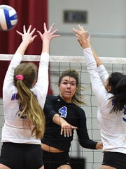 McQueen's Kaila Spevak looks to get the ball past Reno's Abbey Leff, left, and Karson Nakagawa in Tuesday's game at Reno.