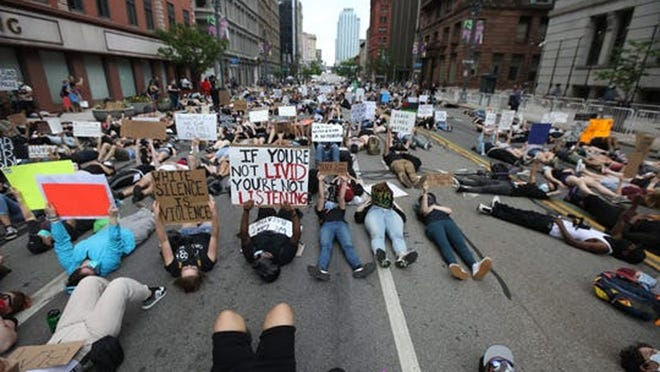 Hundreds of protesters silently lie in the street for eight minutes at the start of the Black Lives Still Matter protest in downtown Rochester on June 5. The eight minutes marked the amount of time that George Floyd, a black Minnesota man, lay before dying with a police officer's knee on his neck.