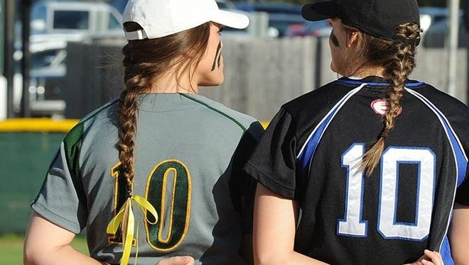 Calvary's Kenzie Glover and Evangel's Bailee Pipes show a pair of 10s in their hands.