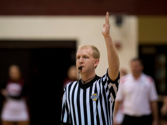 Referee Jevin Redman calls for the clock to stop during Gibson Southern's home game against Southridge Thursday night.