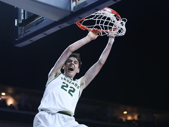 Iowa City West's Patrick McCaffery dunks the ball during