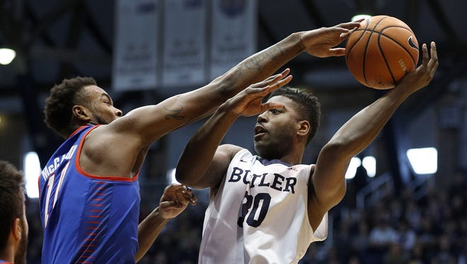 Butler Bulldogs forward Kelan Martin (30) looks to pass the ball around DePaul Blue Demons forward Tre'Darius McCallum (10) in the first half of their game at Hinkle Fieldhouse Saturday, Feb 3, 2018.