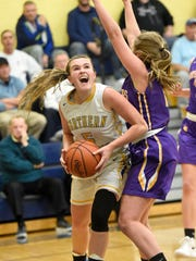 Northern Lebanon's  Liz Voight attempts to push inside the Catholic defense.