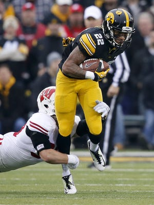 Iowa's Damond Powell breaks a tackle in the first half of Saturday's Big Ten Conference game against Wisconsin.