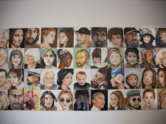 """Artist Paula Van Overbeke Voris's """"Face Quilt,"""" hangs at Red Door Studios in Las Cruces. It's composed of small portraits, each done in just one day. It includes everything from homages to famous works of art, to friends, family and famous Americans."""