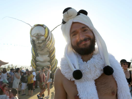 A gentleman outfitted in panda bear attire poses in front of the Coachella Music and Arts Festival on Friday.