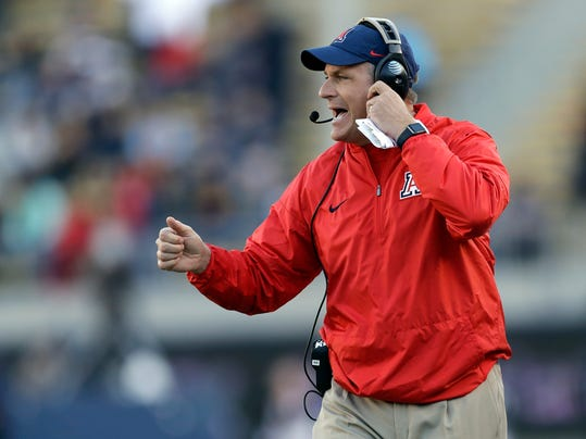 """FILE - In this Oct. 21, 2017, file photo, Arizona coach Rich Rodriguez yells from the sideline during the first half of the team's NCAA college football game against California in Berkeley, Calif. Rodriguez says a claim by his former administrative assistant seeking $7.5 million for sexual harassment is a """"sensationalized tale"""" created to extort him. His attorneys filed a response to the attorney general of Arizona on Monday, Feb. 26, 2018. (AP Photo/Marcio Jose Sanchez, File)"""