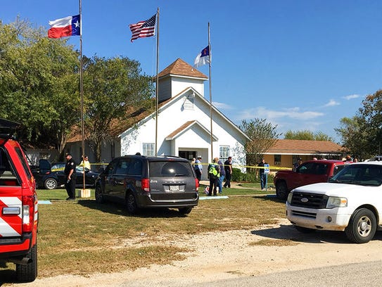 Emergency personnel respond to a fatal shooting at