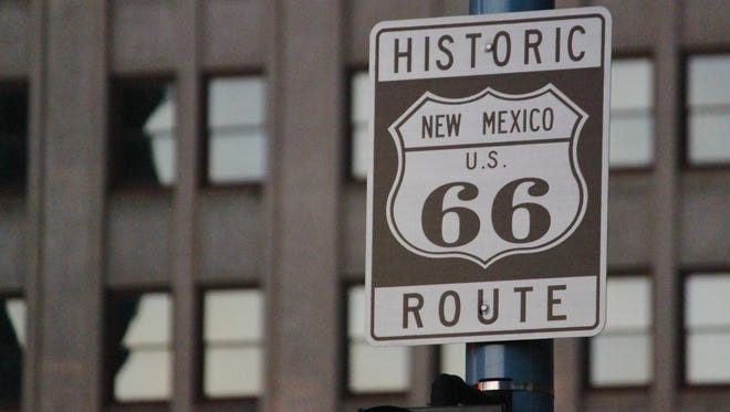 This June 21, 2016 photo shows one of the signs along historic Route 66 in downtown Albuquerque, N.M. The National Park Service has partnered with the nonprofit Cinefemme to create an online collection of stories about the women who lived and worked along the famous highway and were inspired by it.