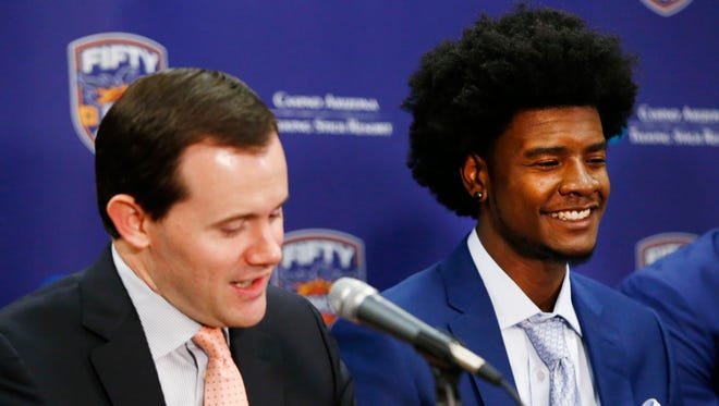 Josh Jackson (right) smiles as GM Ryan McDonough explains the pre-draft workouts during a press conference on Jun. 23, 2017 at at Talking Stick Resort Arena in Phoenix, Ariz. Jackson, the Kansas forward was selected by the Suns with the fourth overall pick in the first round of the 2017 NBA Draft.