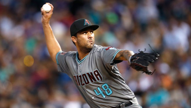 Arizona Diamondbacks relief pitcher Randall Delgado works against a Colorado Rockies batter during the fifth inning of a baseball game Tuesday, July 10, 2018, in Denver.
