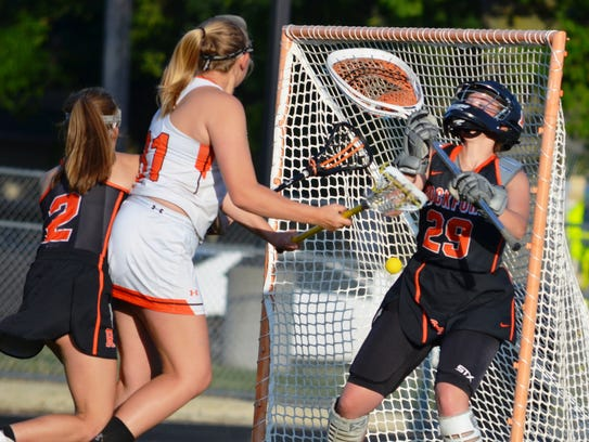 Jessica Tardich (middle) scores Northville's first