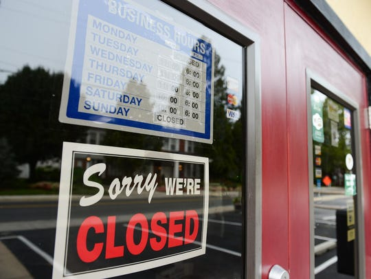 """Signs on the windows of the Berlin Butcher Shop, owned by Lisa Hall, read """"sorry we are closed"""" and """"no trespassing"""" in September 2017."""