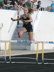 Woodmoe's Carly Rothert competes in preliminaries for the 300 hurdles at regionals.