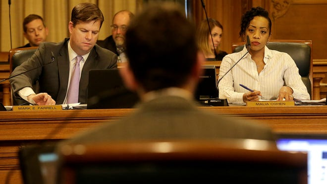 Mark Farrell, left, and Malia Cohen, right, listen as Scott Wiener, foreground, speaks during a San Francisco Board of Supervisors meeting at City Hall in San Francisco, Tuesday, April 5, 2016. San Francisco has approved a measure making it the first place in the nation to require businesses to provide fully paid leave for new parents.