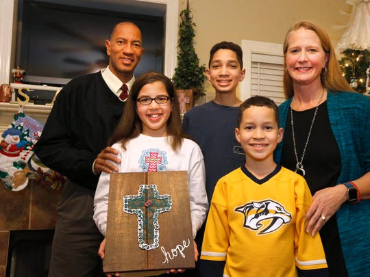 The Nelson family is dad Herman, son A.J., mom Kimberly, daughter Hannah and son Stephen.
