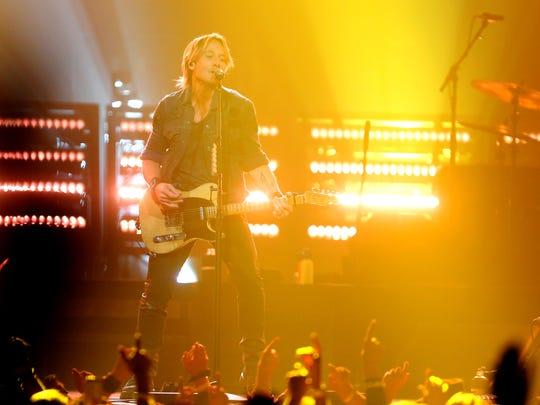 Keith Urban performs at Bridgestone Arena Friday, November
