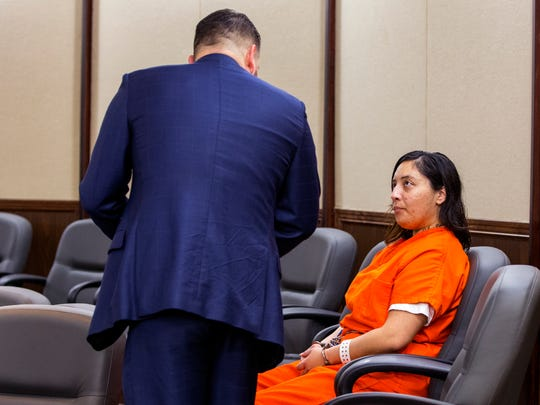 Luis Reyna III (left) confers with his client, Magdalena Yvette Carvajal, who has been charged with tampering with physical evidence in the killing of Breanna Wood. She appeared in Jack Pulcher's 105th District Court on an additional domestic violence charge on Monday, April 30, 2018.
