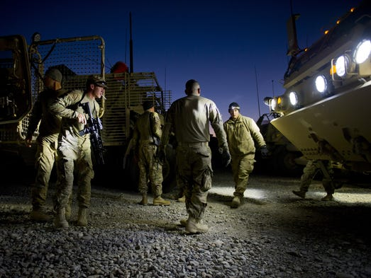 Soldiers prepare their vehicles in the early-morning darkness before a route clearance mission in Zabul province, Afghanistan. <p><br /></p>