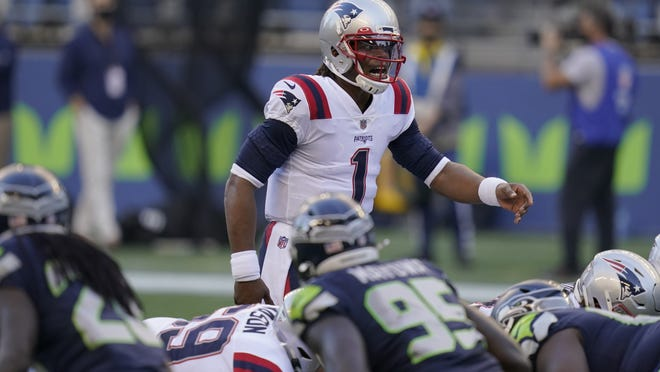 New England Patriots quarterback Cam Newton in action against the Seattle Seahawks Sunday night in Seattle.
