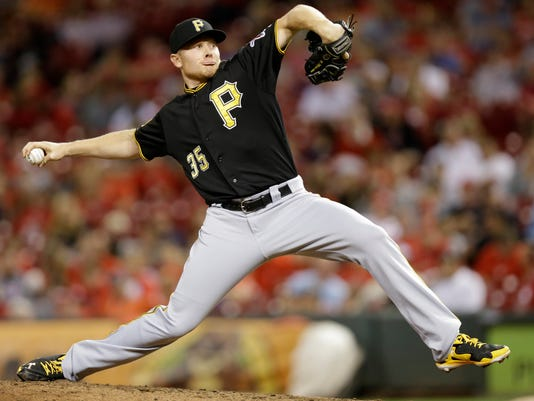 Pittsburgh Pirates relief pitcher Mark Melancon throws against the Cincinnati Reds in the ninth inning of a baseball game, Friday, Sept. 26, 2014, in Cincinnati. Pittsburgh won 3-1. (AP Photo/Al Behrman)