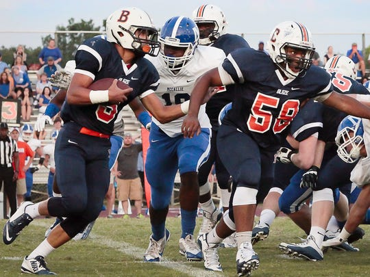 Blackman running back Taeler Dowdy (left) looks for running room in last week's 44-42 win over McCallie.