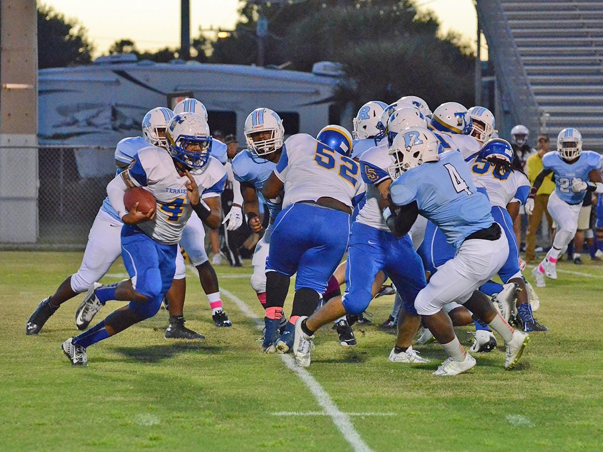 Titusville's Bobby Bruce gets tackled by Rockledge's Laquentin Hastie Jr. Friday night at Rockledge.
