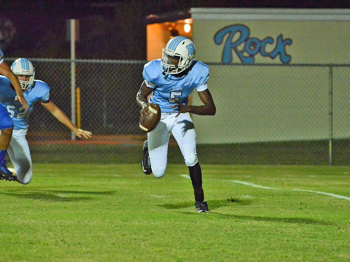 Rockledge quarterback Jaquez Lyons scrambles while looking for a receiver Friday night against Titusville.
