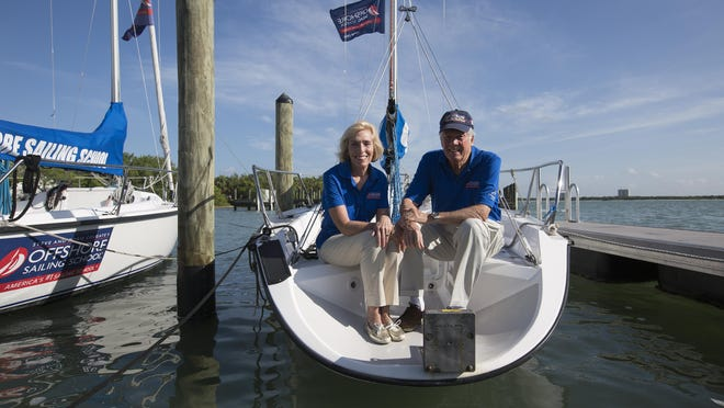Steve and Doris Colgate, founders of the Steve & Doris Colgate Offshore Sailing School sit in one of the boats that is used for the school at the at the Pink Shell Beach Resort and Marina on Fort Myers Beach. The couple has opened up another seasonal location in New York City.