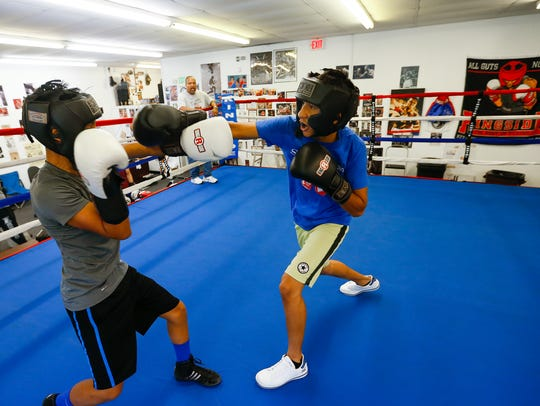 Luis Velasquez (left), 14, and Arturo Moreno, 14, spar