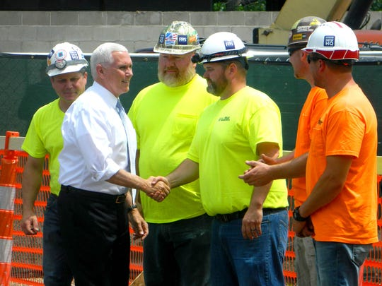 Vice President Mike Pence shakes hands with workers from Rewold and Son before he speaks to supporters at a rally in Rochester on Friday, June 15, 2018.
