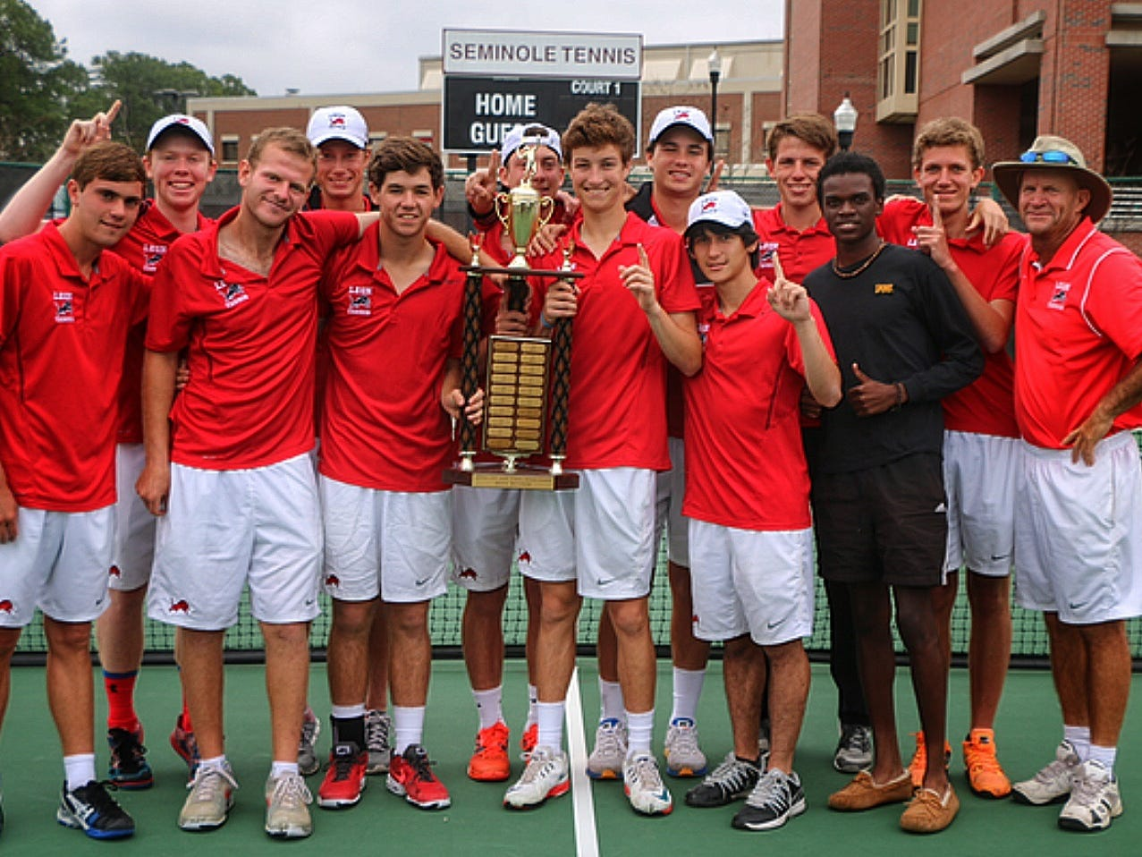 The Leon boys' tennis team after winning another city championship in March. The Lions are making their third straight state tournament appearance beginning Monday.