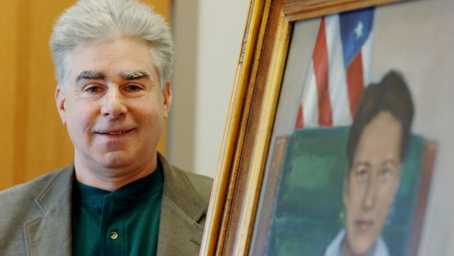 Artist Seth Nadel of Highland stands with his painting of Jane Bolin, the first black female judge of the country and a native of Poughkeepsie on Jan. 28, 2008.